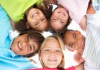 group elementary kids smiling down in circle